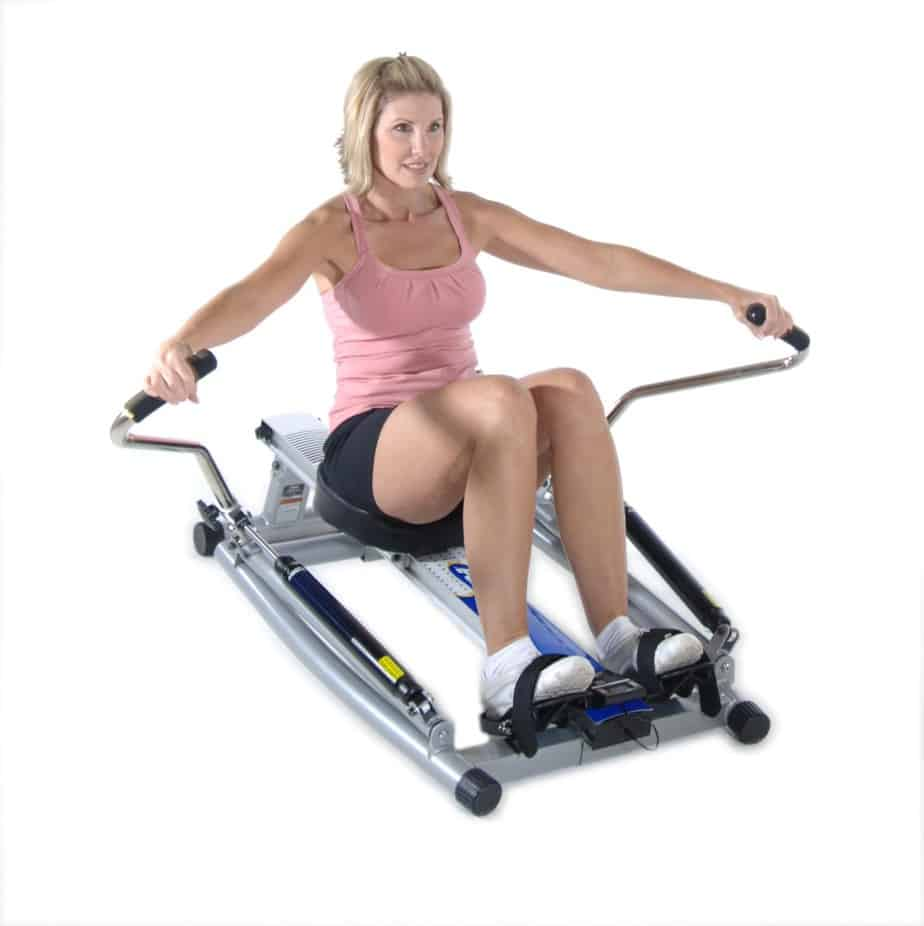 A lady rowing on the Stamina 1215 Orbital Rowing Machine Free Motion Arms