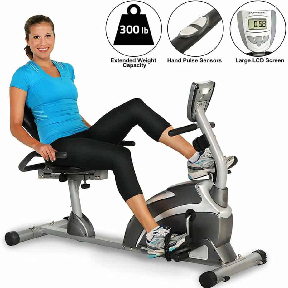 A lady is riding on the Exerpeutic 900XL Magnetic Recumbent Bike Pulse