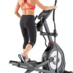 A lady is exercising on the Schwinn 470 Elliptical