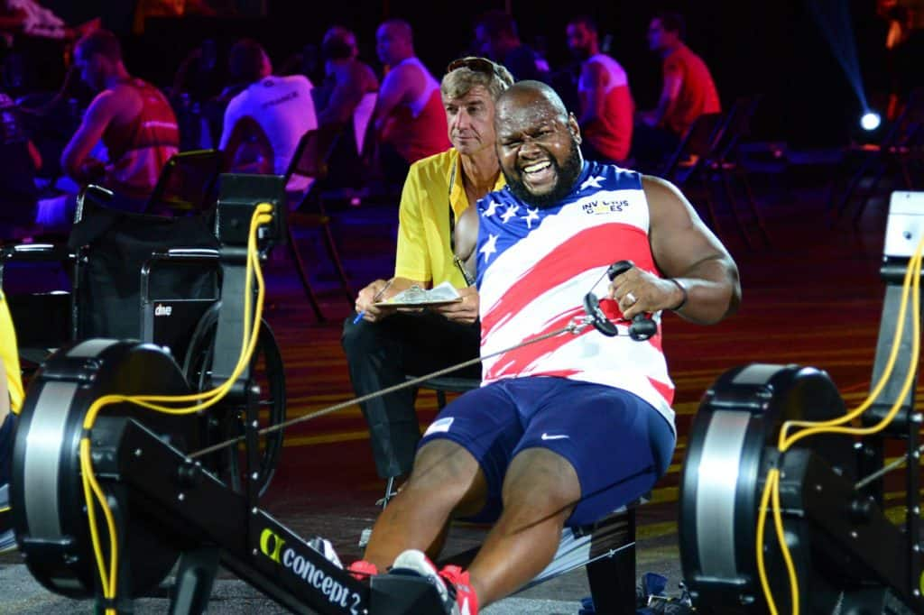 A man exercising on a rower
