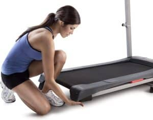A user adjusts the incline of the Weslo Cadence G 5.9 Treadmill
