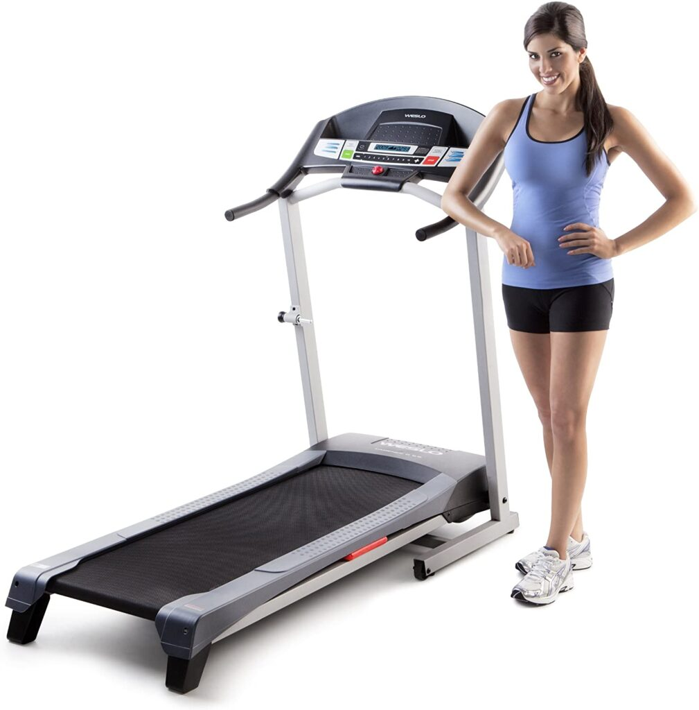 A lady stands by the Weslo Cadence G 5.9 Treadmill