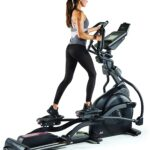 A lady is exercising on the Sole E35 Elliptical Trainer