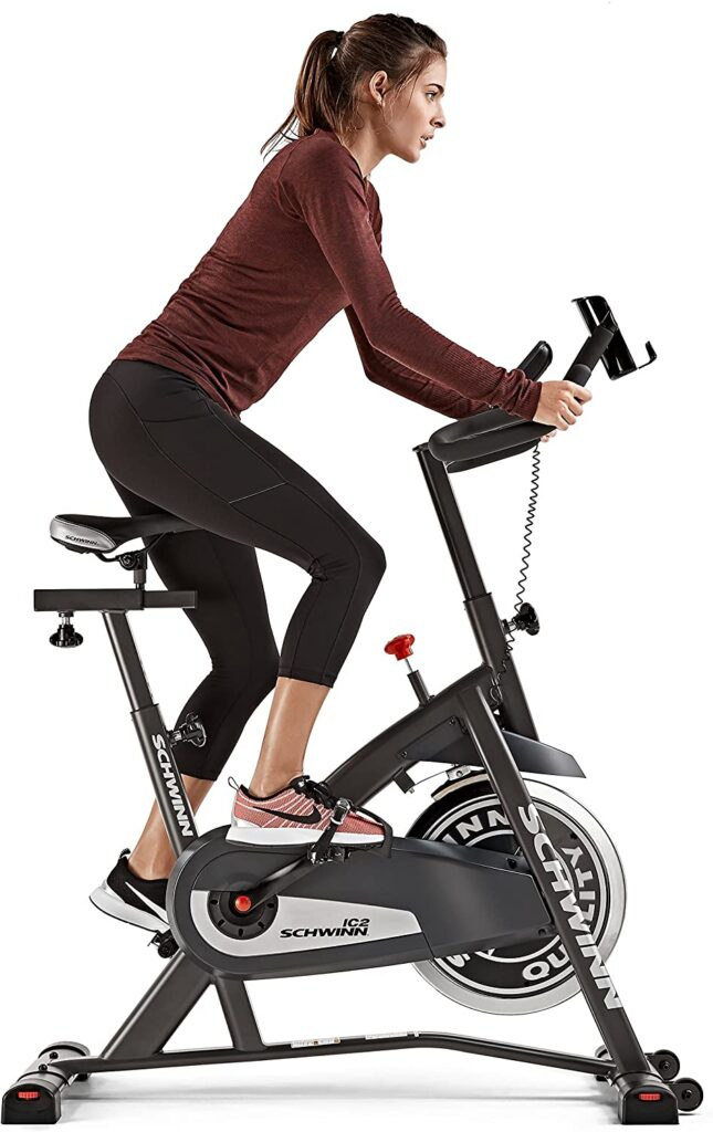 A lady rides the Schwinn IC2 Indoor Cycling Exercise Bike