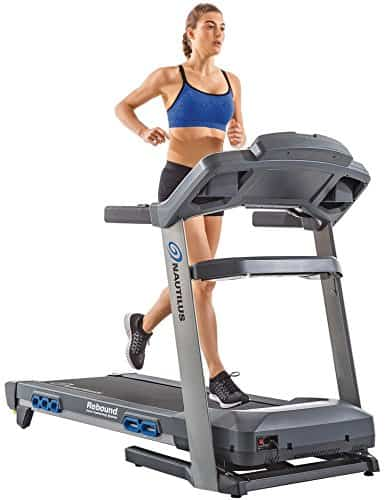 A lady runs on the Nautilus T618 Treadmill Machine Review