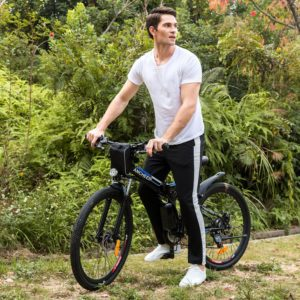 A man is on top of the Ancheer Power Plus Folding Electric Mountain Bike With 26'' Wheel