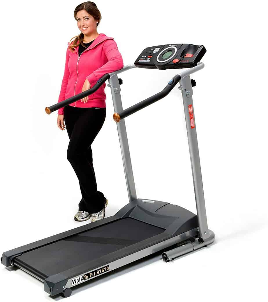 A lady is standing by the Exerpeutic TF900 High Capacity Fitness Walking Electric Treadmill