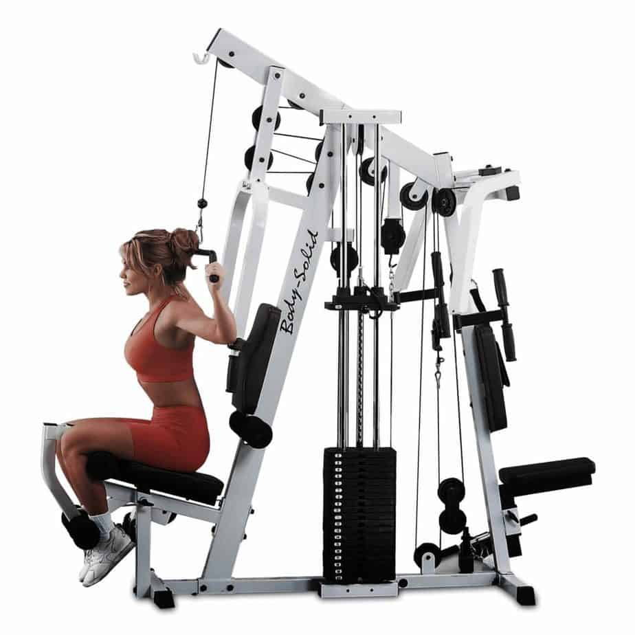Body-Solid Strength Tech EXM2500S Home Gym is being used by a lady