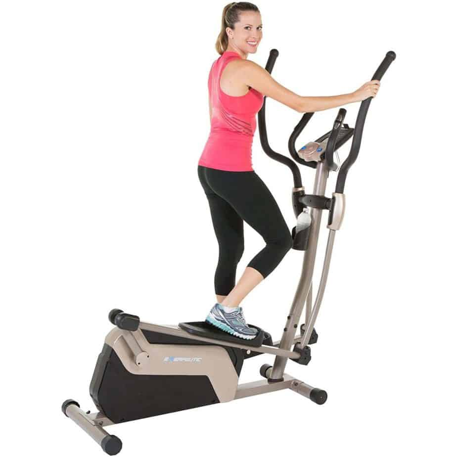 A lady is working out on the Exerpeutic 1318 5000 Magnetic Elliptical Trainer