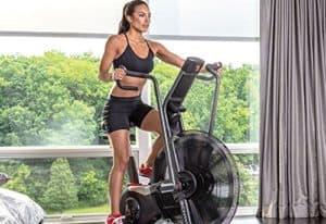 Schwinn Airdyne Pro Exercise Bike is ridden by a woman