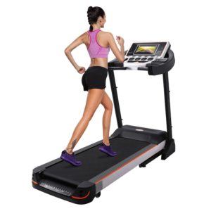 A lady exercising on the Bellar 10.1 Inch WIFI Large Color Touch Screen 3.0 HP Folding Electric Treadmill