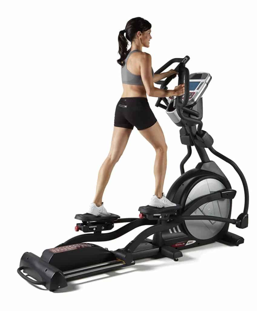A lady is working out on the Sole E95 Elliptical