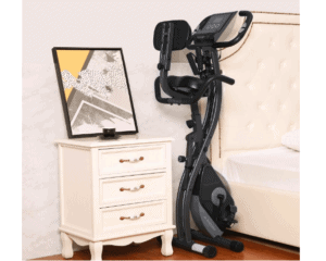 MaxKare Magnetic Folding Semi-Recumbent Bike stored at a bed side