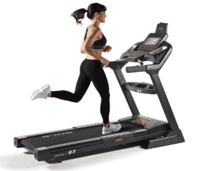 A lady is running on the Sole F63 2019 Folding Treadmill