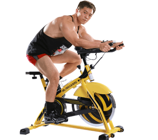 MaxKare Stationary Cycling Spin Bike is being ridden by a man