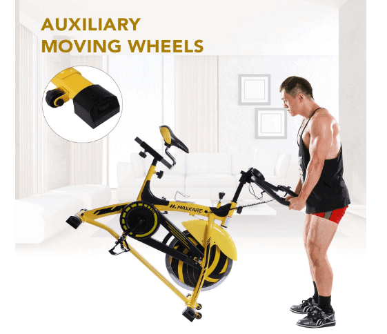 MaxKare Stationary Cycling Spin Bike is being moved to another location by a man