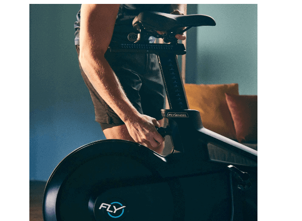 The Flywheel Home Exercise Bikes seat being adjusted