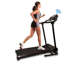 A woman is jogging on the SereneLife Smart Digital Folding Electric Motorized Treadmill SLFTRD18
