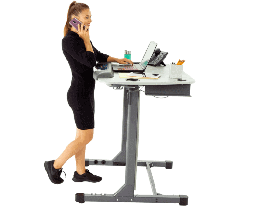 A lady using the standing desk of the Exerpeutic 5000 ExerWork Desk Treadmill Model 7906