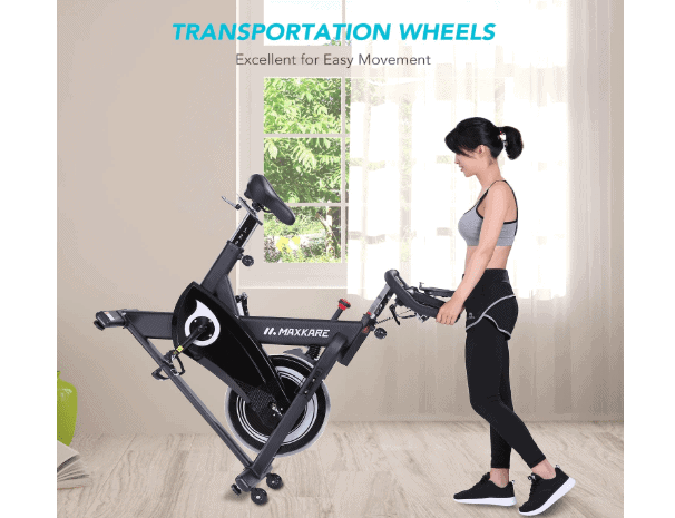 MaxKare Magnetic Indoor Cycling Bike is being roll away to storage location by a woman