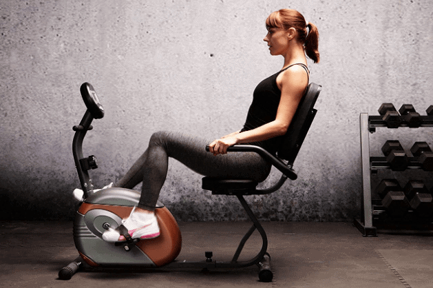 The Exerpeutic Magnetic Recumbent ME-709 Bike is being ridden by a lady