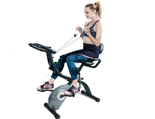 A lady riding the ATIVAFIT Stationary Foldable Exercise Bike while using the arm resistance bands