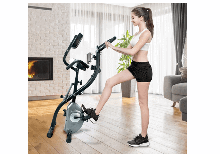 A lady rolling the ATIVAFIT Stationary Foldable Exercise Bike away for storage