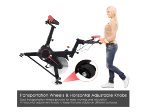 The GOPLUS Indoor Cycling Bike V is being moved to a storage location by a lady