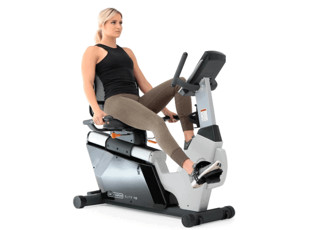 A lady riding the 3G Cardio Elite RB Recumbent Bike