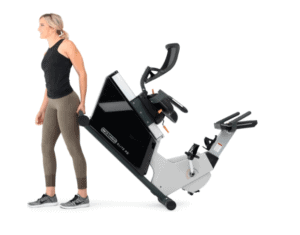 The 3G Cardio Elite RB Recumbent Bike is being rolled away to a storage area