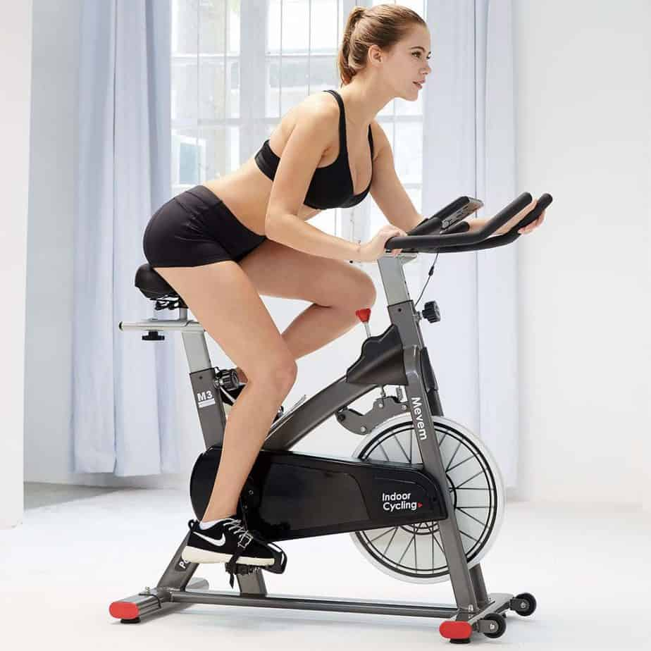 A lady riding the MEVEM Magnetic Indoor Cycling Bike
