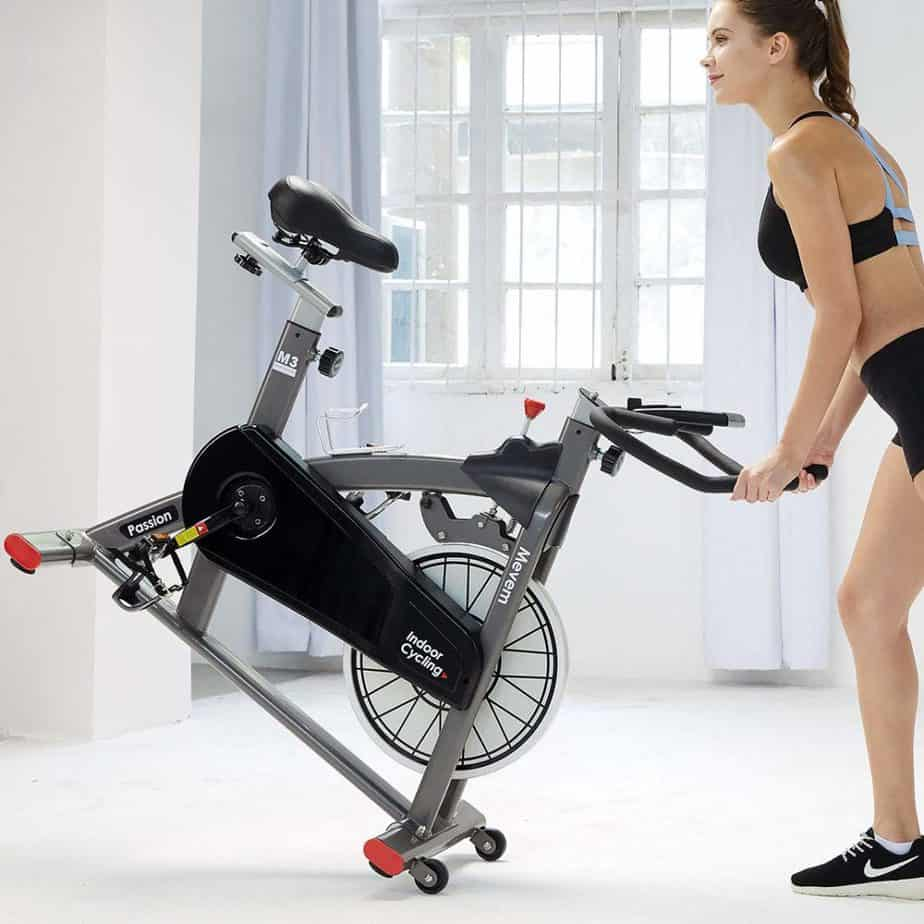 MEVEM Magnetic Indoor Cycling Bike being rolled away to and from storage