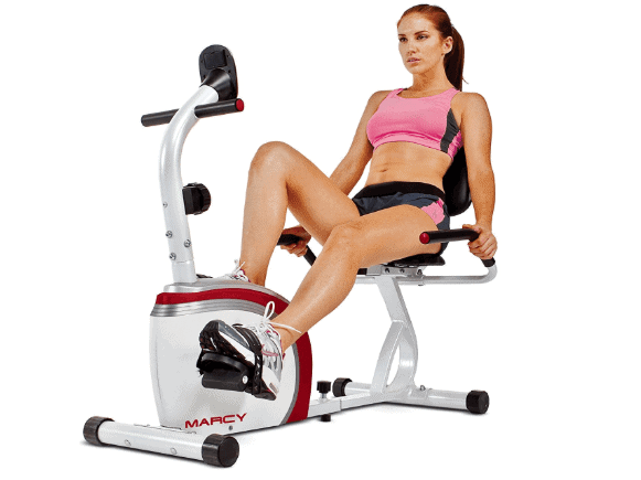 A lady riding the Marcy Recumbent Exercise Bike with Pulse Sensors NS-908R