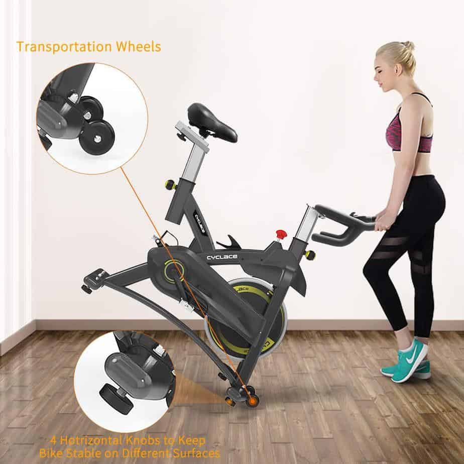 The Cyclace Indoor Exercise Bike is being moved to storage by a lady