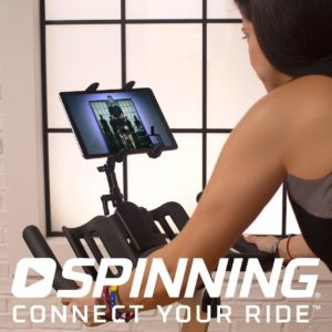 Spinner P3 Indoor Cycling Bike is being ridden by a lady that is also streaming spin bike training