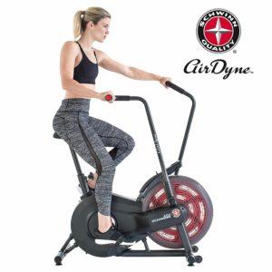 A lady athlete is riding the Schwinn AD2 Airdyne Bike