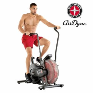 An man is working out on the Schwinn AD2 Airdyne Bike