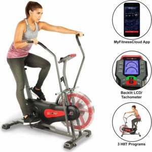 A lady is riding the Fitness Reality 1000AR Bluetooth Air Resistance Bike