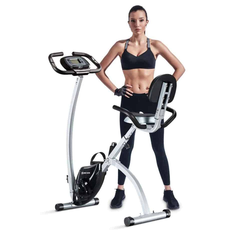 An athlete standing beside the BCAN Folding Exercise Bike