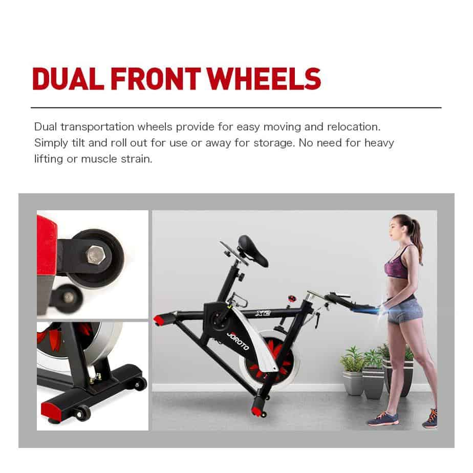 A lady rolling the Joroto X2 Indoor Cycling Bike away to storage