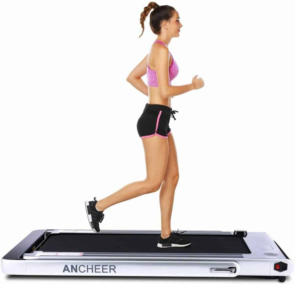 An athlete uses the ANCHEER 2-in-1 Folding Treadmill in under-desk mode