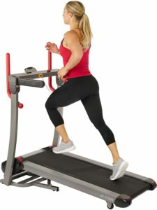 A lady jogging on the Sunny Health & Fitness Folding Electric Treadmill SF-T7909