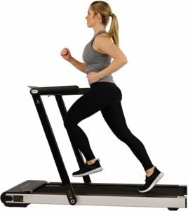 A lady-athlete is jogging on the Sunny Health & Fitness ASUNA 8730 Treadmill