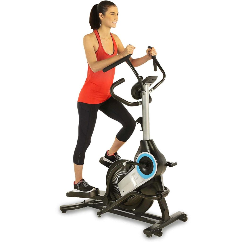 A lady riding on the ProGear 9900 Stepper Elliptical Trainer