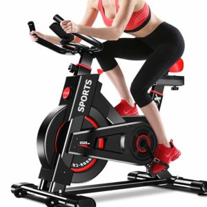 A lady exercising with the Dripex Indoor Exercise Bike