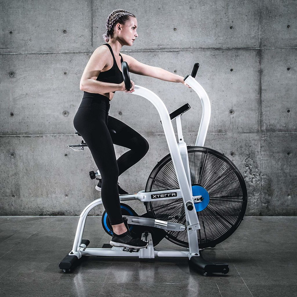 A lady riding the XTERRA Fitness AIR650 Airbike Pro