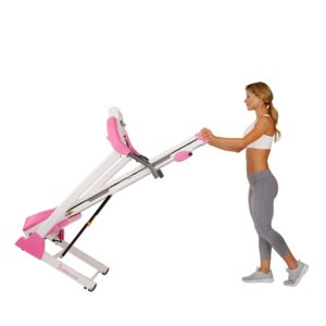 A lady is rolling the Sunny Health & Fitness P8700 Treadmill to storage