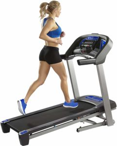 A lady is exercising on theHorizon T101 Treadmill (2018)