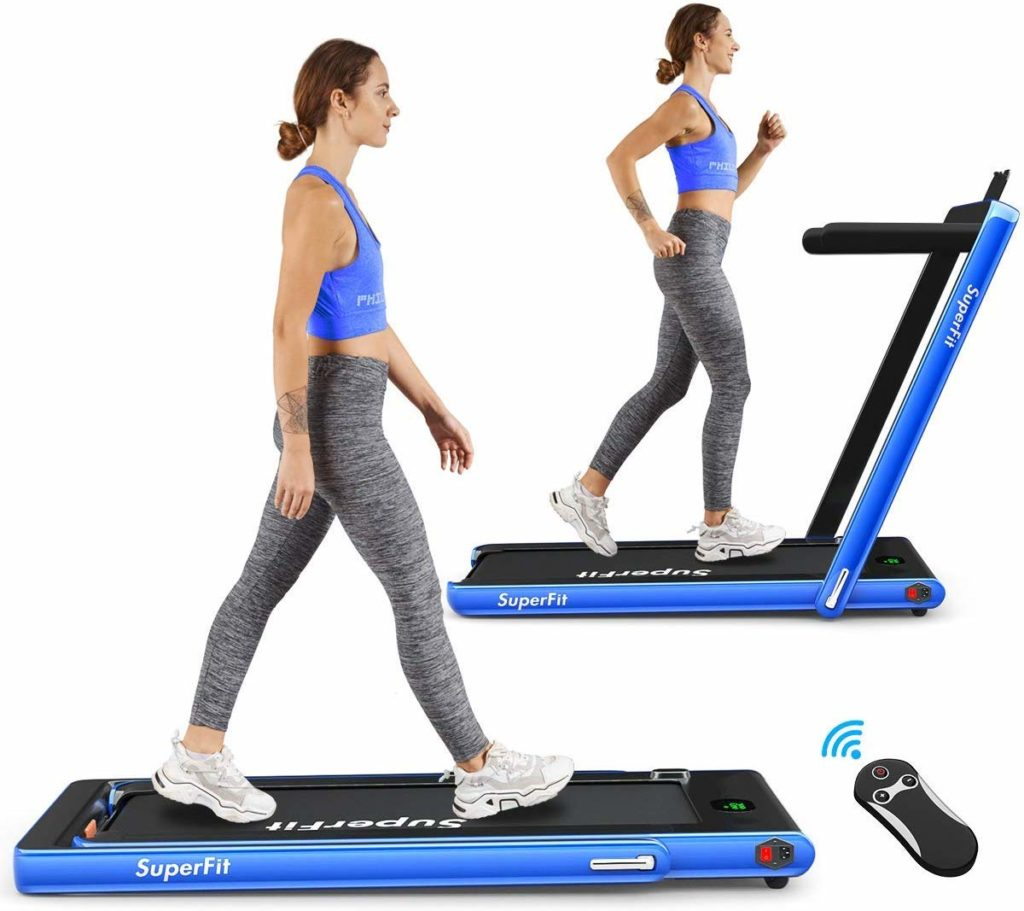 A lady is walking and jogging on the Goplus 2 in 1 Folding Treadmill