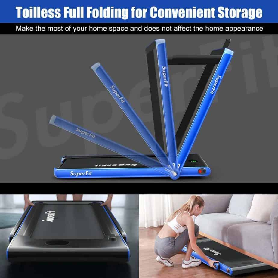 The Goplus 2 in 1 Folding Treadmill being folded and stored under the couch by a lady